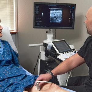 Dr Aaron Kovaleski with patient